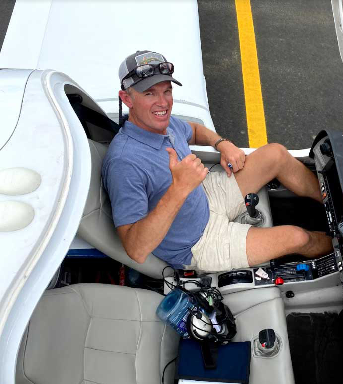 Tom Filippini piloting his plane